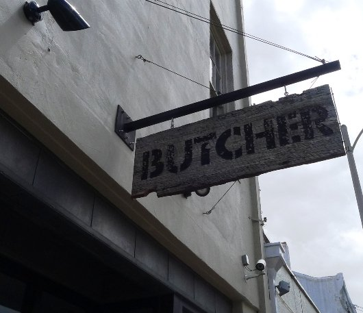 Sign outside of Cochon Butcher in New Orleans, NC Triangle Dining