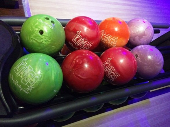 Big, shiny bowling balls at Kings Bowl North Hills in Raleigh- NC Triangle Dining