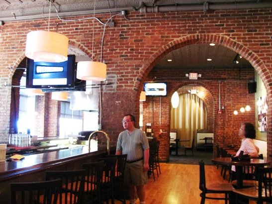 Brick interior of David's Dumpling & Noodle Bar in Raleigh - NC Triangle Dining