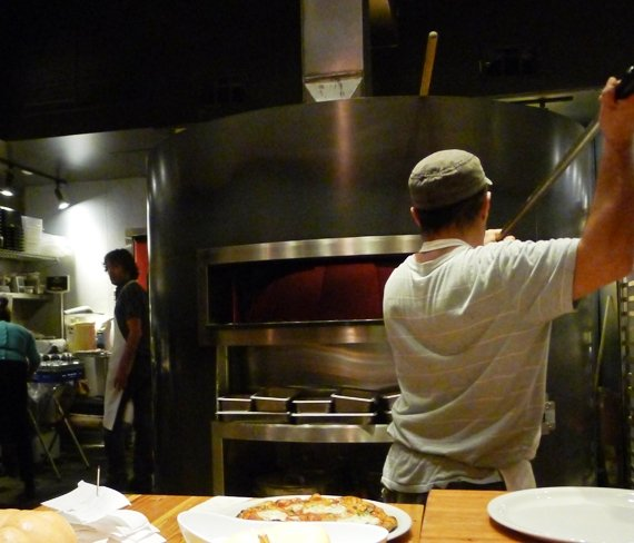 Wood-fired oven at Pizzeria Toro in Durham, NC Triangle Dining