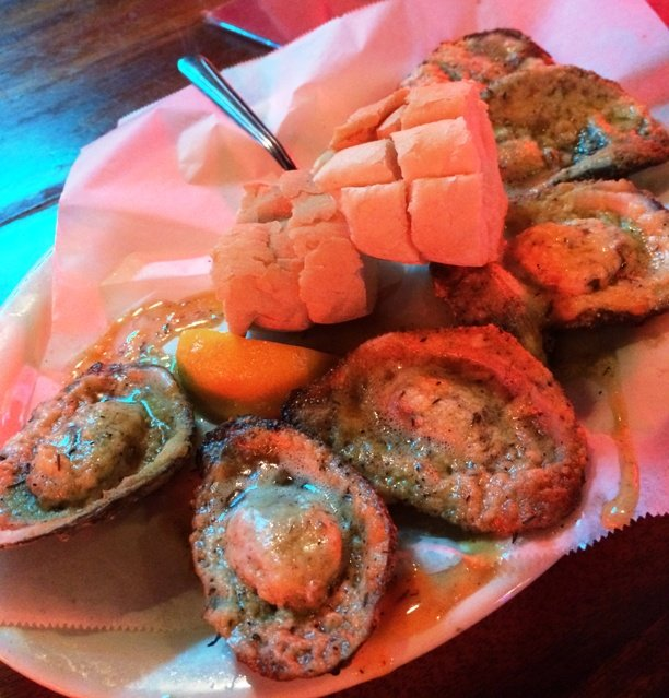 Char-grilled oysters at Acme Oyster House, New Orleans- NC Triangle Dining