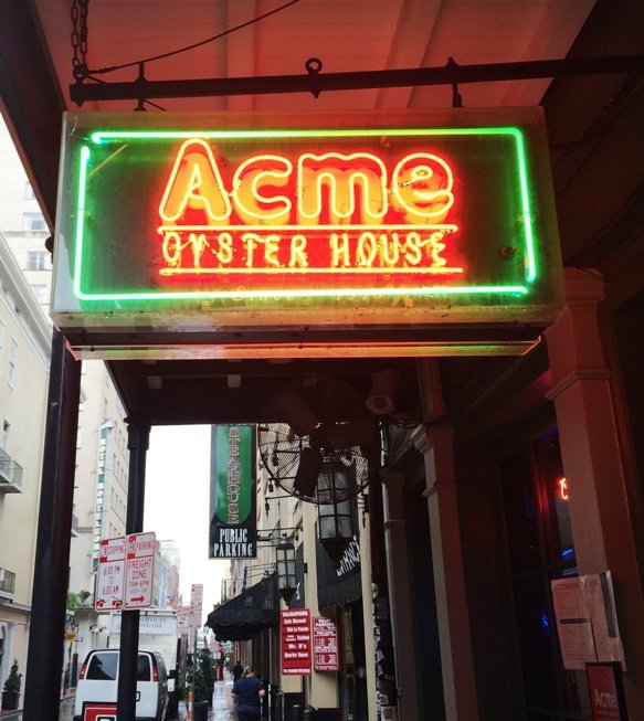 Neon sign in front of Acme Oyster House, New Orleans- NC Triangle Dining