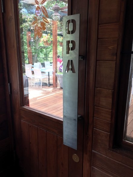 Greek greetings at Taverna Agora's patio door, Raleigh- NC Triangle Dining