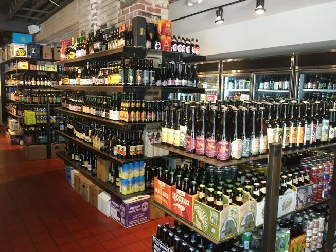 Bottle shelves at State of Beer, Raleigh- NC Triangle Dining