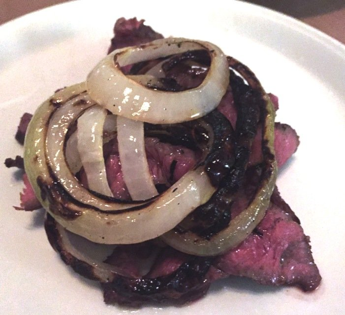 Sliced steak at Gocciolina in Durham- NC Triangle Dining