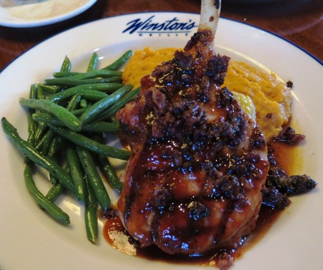 Pork chop with bourbon-maple glaze at Winston's Grille in Raleigh- NC Triangle Dining