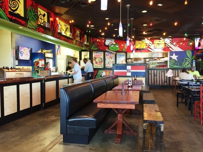Bright and cheery interior at Tropical Picken Chicken in Raleigh- NC Triangle Dining