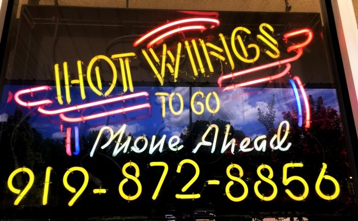 Neon sign at Wing Stop in Raleigh- NC Triangle Dining