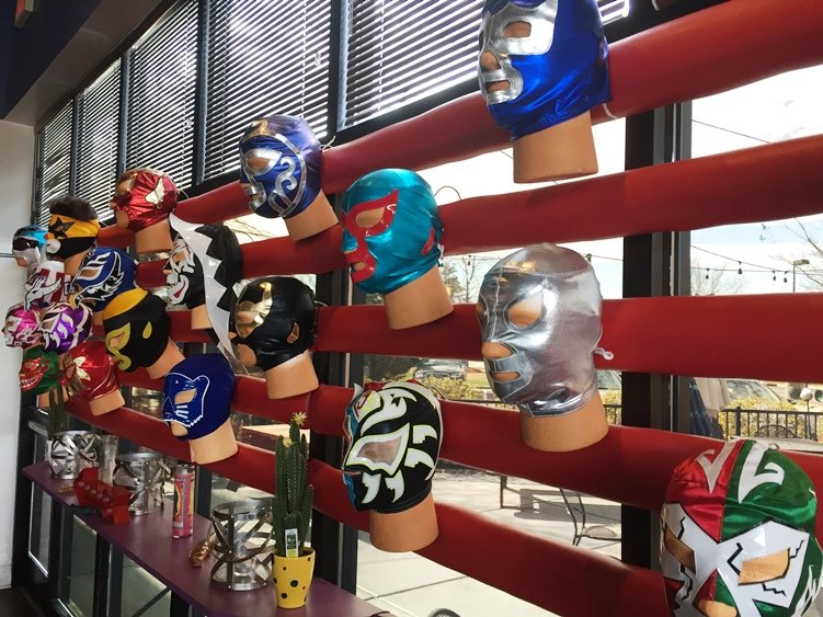 Luchador mask display at Viva DF in Morrisville - NC Triangle Dining