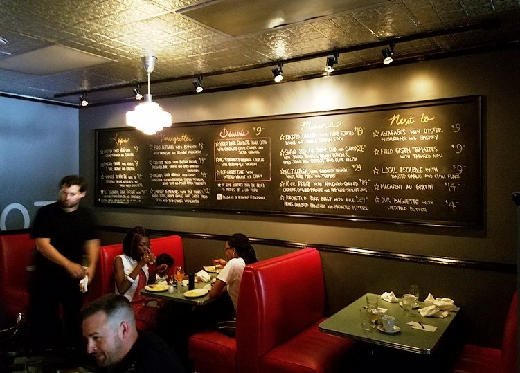 Seating and chalkboard menus at Poole's Diner in Raleigh - nctriangledining.com