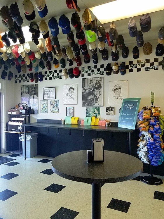 Order form area and ceiling covered with hats at Steve's Place in Raleigh - NC Triangle Dining